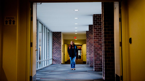 Students walking down hallway in residence hall