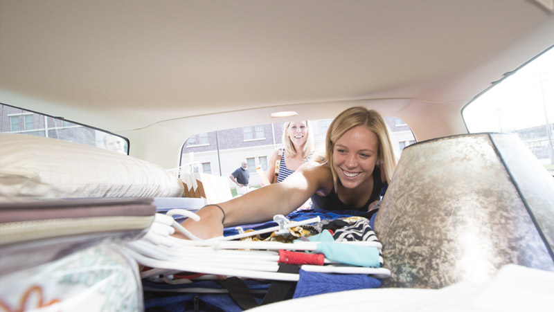 Student unloading her car for move-in