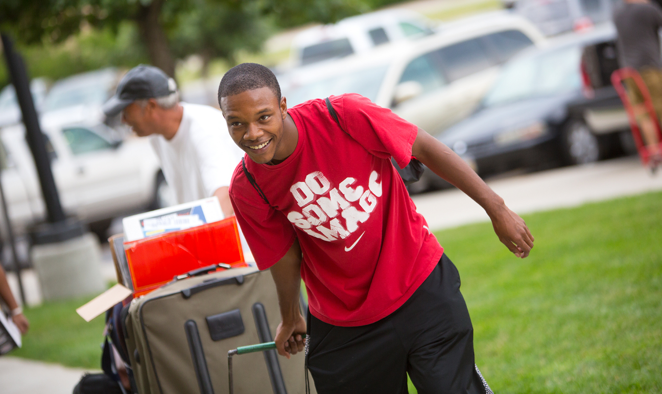 Freshman moving into his new dorm