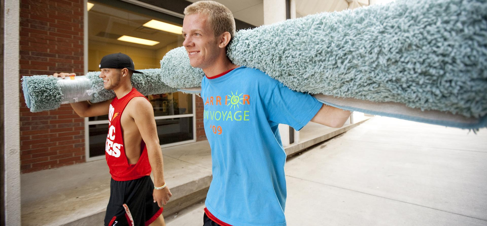Carrying in carpet for move-in weekend.