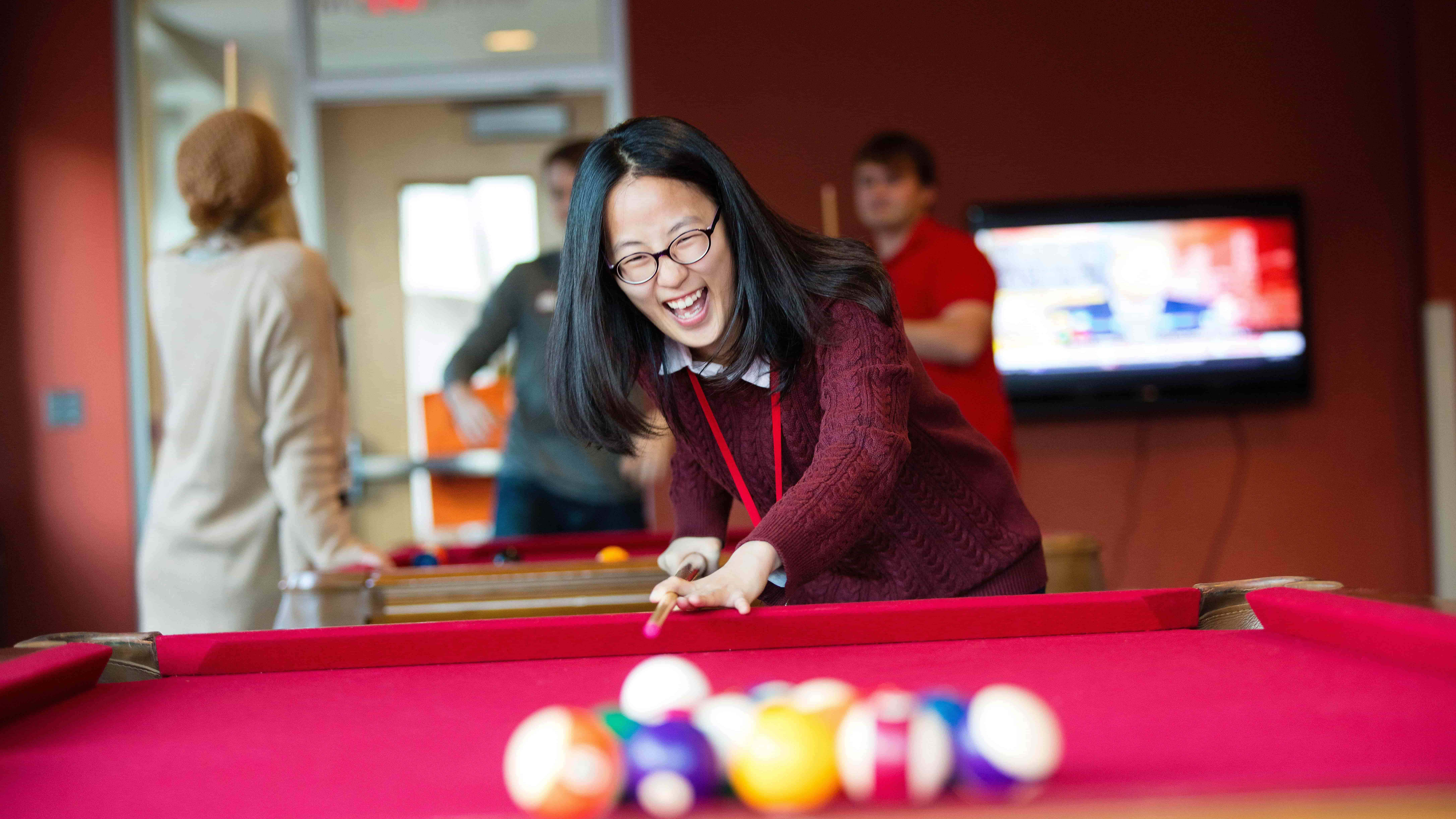 International student playing pool
